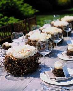 Fill birds nests with freshly cut (or paper or fabric) flowers as centerpieces.