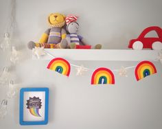 Three felt rainbows and four glitter stars hang from white satin ribbon to add a magical touch to babys room. IMPORTANT* Please add a note to your order with colour choices. Glitter stars available in: pearlescent, pale pink, mint, lilac, silver, dusky pink, blue, turquoise, bronze, gold, pale gold, midnight blue, pale yellow, spearmint, bright pink.  I make and design all of my items so if you have a special request or would like something individual please do get in touch. All my work is…