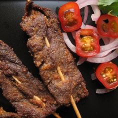 Typical Nigerian food is suya: bbq'd peanut-marinaded meat on sticks, perfect for Nigerians and others in diaspora