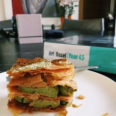 Two big slices of my afternoon - this Matcha Napoleon and the Art Basel book behind. #thedailygrind