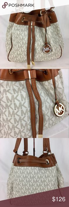 """Michael Kors Women's Marina Large Drawstring Tote Condition: Gently used with care card. Good condition throughout.   A slouchy MICHAEL Michael Kors tote in rich canvas with smooth leather trim. A slim drawstring gathers the top. Logo-lined interior contains 5 pockets and a tethered drawstrings. Metal feet. Top handles. Double handles with 11"""" drop, Interior features 1 zip pocket, 3 open pockets, 1 cell phone pocket, 1 key fob. 14"""" W x 11-1/2"""" H x 6-1/2"""" D   Thank you for your interest! No…"""