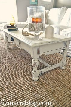 White distressed coffee table. Will probably be how ours ends up looking!
