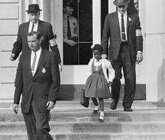 As a six-year-old, Ruby Bridges famously became the first African American child to desegregate an all-white elementary school in the South. When the 1st grader walked to William Frantz Elementary School in New Orleans on November 14, 1960 surrounded by a team of U.S. Marshals, she was met by a vicious mob shouting and throwing objects at her.
