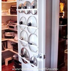 pantry organization idea: Use Towel rods to hold lids