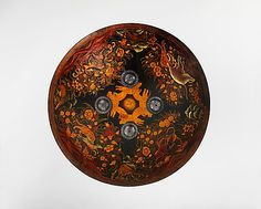Shield                                                                                      Date:                                        ca. 1800                                                          Culture:                                        Indian                                                          Medium:                                        Leather, translucent lacquer over gold leaf, silver
