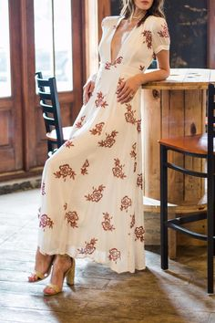 Sexy, deep plunging neckline and flowy silhouette make us want to make a romantic getaway in a vineyard far far away.    Temptress Maxi Dress by On The Road. Clothing - Dresses - Printed Clothing - Dresses - Maxi Clothing - Dresses - Floral Clothing - Dresses - Formal Clothing - Dresses - Short Sleeve Mississippi
