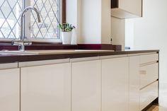 Handleless Gloss Cream and Walnut Nolte Alpha Lack Kitchen
