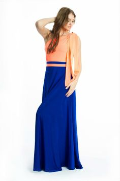 his colorful summer dress is an ideal look for effortless desk-to-dinner style. Asymmetrical neckline. Single draped sleeve. Cinched waist. Cascading ruffle detail at side. Concealed side zipper with hook-and-eye closure. Jersey and Chiffon