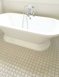 Love this classic white octagon mosaic floor tile!  |  Bathroom Inspiration…