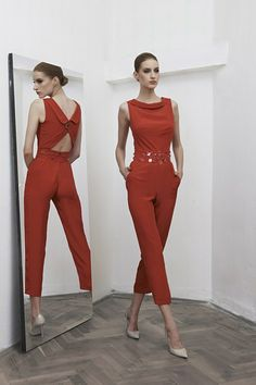 It looks like the jumpsuit will be making a comeback  for spring/summer 2014 and the trend is a confusing one to me personally. In order to rock it, one will need to be very tall and lean but then the backside happens. Super chic in the front, butt crack in the back???? I'm going to have to think about this...
