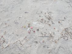 Follow the high tide mark to see a line of trash and fireworks debris. 7.11.14  ♥︎ Mommy Moo Moo