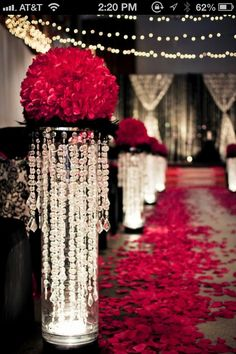 Red black wedding --- my colors!!!!! wow.. wonder how much to rent these. im sure its too much to purchase! i love this! takes it to a whole different level!