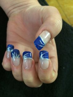 One of my clients went for this crazy nail art idea for her big wedding day. It is a royal blue french with silver gel hand art and initials in Gel*Acrylic.
