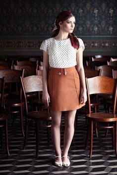 "Short brown denim ""Yula"" skirt."