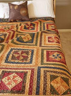 'Tis the season for autumn bed-size quilt patterns! Bring on the pumpkins, apple cider, and beautiful fall prints. Rich fabrics were fashioned into two favorite Pinwheel blocks for this traditional autumn quilt. The warm hued prints that are used in these quilt blocks make for a cheerful and lively quilt. Frame it with a rich dark green border to bring it all together. Perfect for your seasonal décor or year-round, if you please!