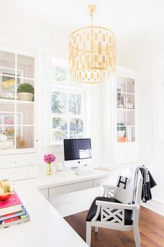Laura Burleson Interiors - Beautiful home office features an L shaped floating desk paired with a white lattice chair accented with a black vinyl seat cushion and a black Hermes Avalon Blanket.