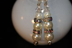 Hey, I found this really awesome Etsy listing at https://www.etsy.com/listing/182620583/3-pearl-and-rhinestone-earrings-hand