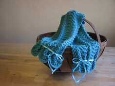 teal knitted scarf with ribbon detail