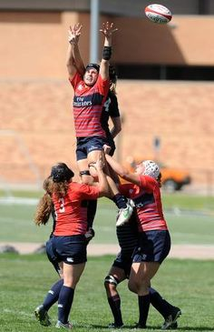 JIM RYDBOM/ Members of the USA Women's Rugby National Team fight for the ball during a throw in at a scrimmage on Wednesday at the University of Northern Colorado Butler Hancock practice fields.
