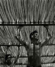 """Herbert List. SPAIN. Andalucia. Torremolinos. 1951. """"Young men under reed roof""""."""