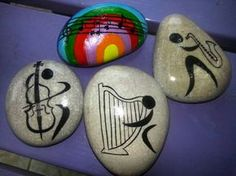 Music playing instruments painted rocks