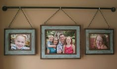 Picture Frames hanging on plumbing pieces