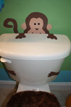 My monkey toilet to match my girls Monkey bathroom. I drew the monkey coming up behind the toilet, then i cut out arms with paws and stuck them like he was holding on to the top and his legs are hugging the toilet
