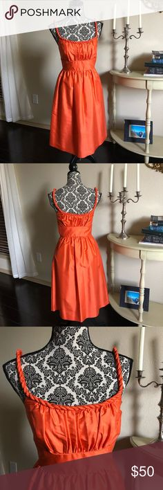 J Crew Collection Dress Absolutely stunning orange J Crew Collection Dress. 100% Silk, lining is 100% cotton. Worn once. Twisted rope style straps that line the neckline as well. Side zips. Such a beautiful piece! J. Crew Dresses Midi