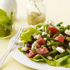 A trio of beans are combined with fragrant basil leaves, tomatoes, and mozzarella cheese in this delicious salad recipe that can be ready in less than 30 minutes.