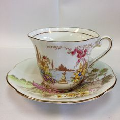 A stunning Taylor & Kent from Longton, England, Bone China Tea Cup and Saucer c.1940-1950 is in the house! This beautifully detailed item is in mint condition - no damages. The gold trim is displayed perfectly around the tea cup, handle, and saucer. This item shows a truly profound scenery with strong and bright colors. Bring this darling home today! Measurements: Tea Cup: Height: 3 Width: 4 Saucer: Height: 1 Width: 5 1/2 #5921