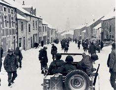The Ardennes 1944-1945: American infantrymen of the 87th Div., enter the town of Saint-Hubert, right after the Germans fled the town.
