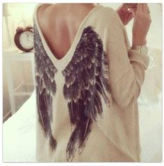 this is so cool i love the wings on the back of this sweater