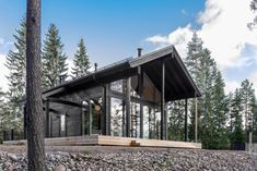 Iniö has a high-ceilinged terrace, and is fitted with generous floor-to-ceiling windows in the living room and dining area that bring in plenty of natural light. #cabin #scandinavian
