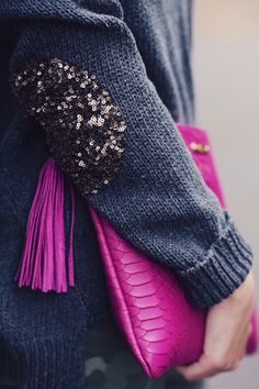 Sparkly elbow patches. Colorful clutch.