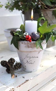 planting pot with ornaments and candle...great look!