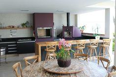Varanda Gourmet com churrasqueira, forno de pizza e cooktop - projeto residencial de RF Design de Interiores