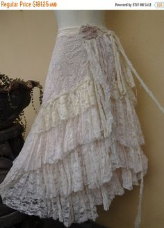Shes a gorgeous bohemian wrap around vintage inspired skirt kissed with assorted ivory bridal laces,netting and shabby detail with roses where she ties