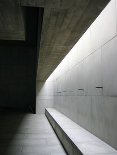 The chapel of the holy cross in Turku Finland utilizes the somber nature of concrete to create a dialouge about life and the after life.