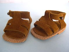 Doll Shoes made to fit American Girl and other 18 inch dolls I made these doll sandals out of suede using McCall's doll pattern 3469 soles are cork (made by Barb Marlee)