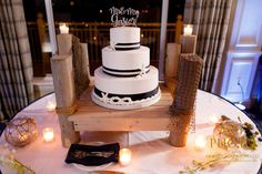 Very cool Nautical wedding cake set on a mini dock shown at the reception for the bride and groom following their wedding ceremony at Harbour Ridge Yacht and Country Club in Pt St Lucie Florida.