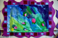 """Monet´s Waterlilies.""""The background is tempera paint, the flowers are tissue paper on top of lily pads that are made from pre painted paper."""""""