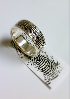Hey, I found this really awesome Etsy listing at https://www.etsy.com/listing/107118336/finger-print-wedding-band
