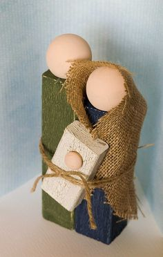 DIY Simple Wooden Holy Family Nativity. Love the burlap addition on this version-totally doable for my craft show if I could buy some wooden balls.