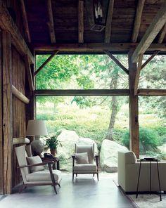 Rustic outdoor living room with a Mid-century modern twist. {via summerfielddesign.wordpress.com}