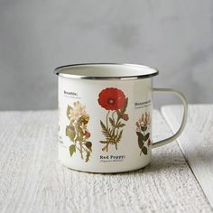 Enamel Wildflower Mug This old-fashioned steel cup with enamel finish shows colorful illustrations of wildflowers in any shape and size. – Stainless steel, enamel- H Coffee Shop, Coffee Cups, Big Coffee, Kitchenware, Tableware, Cool Mugs, Mug Cup, Wild Flowers, Tea Pots