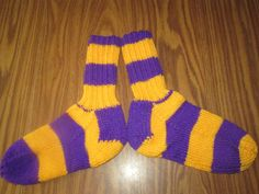 Here is a wonderful pair of hand knit adult size socks. Heel to toe is approx. 9 1/2 in. and the ribbing on the top (top to ankle) is approx. 6 1/2 in. The yarn color is called Purple and Gold. These socks are made of 100% acrylic yarn and can be machine washed and dried.