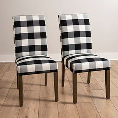 Dine in style with our beautiful Black and White Buffalo Check Dining Chair. You'll love the farmhouse inspired look of this plush upholstered dining chair.             Chair measures 29L x 18W x 30H in.          Crafted with a wood and wood composite frame          Upholstered in black and white 100% polyester fabric          Brown leg finish          Features buffalo plaid pattern          Weight: 13.22 lbs.          Weight capacity: 225 lbs.          Some assembly required          Not… White Kitchen Chairs, Black And White Dining Room, Black Dining Room Chairs, Upholstered Dining Chairs, Dining Furniture, Table And Chairs, Buffalo Check Chair, Plaid Chair, White Farmhouse Kitchens