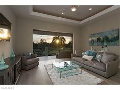875 WEDGE Dr, Naples, FL 34103   The coastal den has sunset views over the golf course at Moorings Country Club.  The Moorings   Naples Coastal Contemporary Homes for Sale