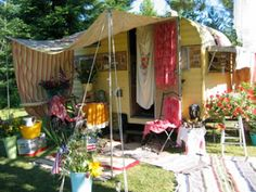 Girl Camping, cute awning photo, hiding your luggable loo