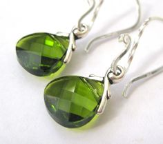 love these earrings, sterling silver and Swarovski crystals. JewelrybyDorothy, fond on Etsy